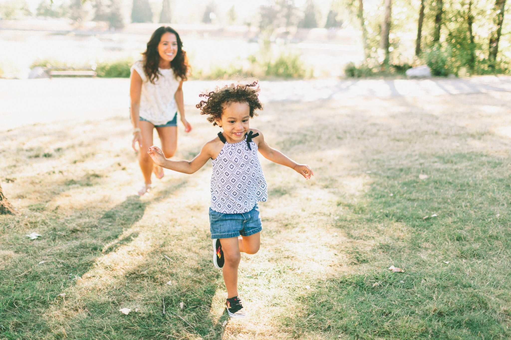 mother daughter playing outside | financial advice for moms